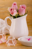Phial with rose oil — Stock Photo