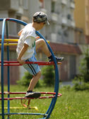 Boy climbing on the climbing frames at the playground — Stock Photo