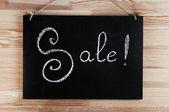 Sale! written on black board — Stockfoto