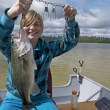 Girl Who Caught A Bass — Stock Photo #64414205