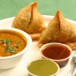 Samosa is an Indian fried or baked pastry. — Stock Photo #52941929