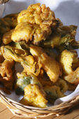 Vegetable Fritters - a snack made from cut vegetables and gram flour — Stock Photo