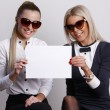 Two girls holding blank paper — Stock Photo #64563951