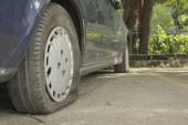 Abandon blue car in parking lot with flat tires — Foto Stock