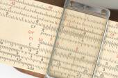 Closeup of Antique calculater, slide rule, over white background. — Stock Photo