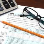 Tax Preparation - Financial IRS Individual Tax Return 1040 Form — Stock Photo #63402121