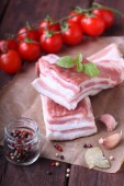 Fat layers with meat,tomatoes, pepper and salt — Stock Photo
