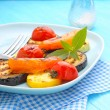 Grilled vegetables on a blue plate — Stock Photo #79014158