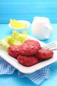Cutlets of meat on a white plate — Stock Photo
