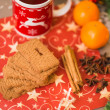 Christmas tea with biscuits, cinnamon, anise stars and tangerine — Stock Photo #60551611