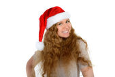 Attractive young woman with rad hair in santa hat — Stock Photo