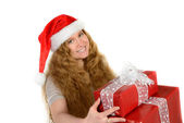Attractive young woman with rad hair in santa hat with christmas — Stock Photo