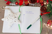 New year's resolutions written on a notepad with a star and new  — Stock Photo