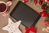 Tablet with a new year decoration — Stock Photo