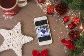 Mobile phone in retro xmas decoration — Stock Photo
