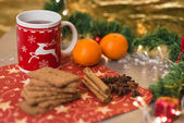 Christmas tea with biscuits, cinnamon, anise stars and tangerine — Stock Photo