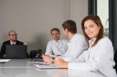 Medical consultation with three doctors and businesman — Stock Photo