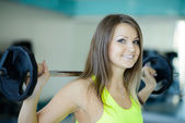 Strong young woman with beautiful athletic body doing exercises  — 图库照片