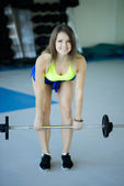 Strong young woman with beautiful athletic body doing exercises  — Stock Photo