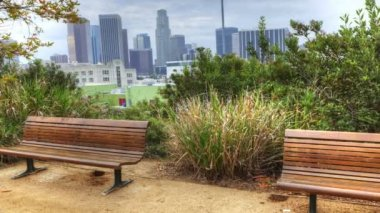 View of Los Angeles skyline with park bench in the foreground — Stock Video