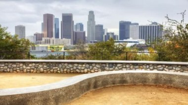 View of Los Angeles skyline with stone dike in the foreground — Stock Video