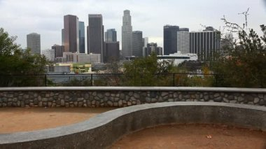 A View of Los Angeles skyline with stone dike in the foreground — Stock Video