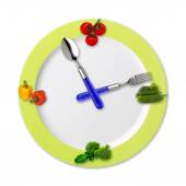 Kitchen clock with vegetables — Stock Photo