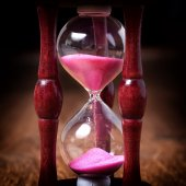 Close-up Hourglass on wood background, antique tone — Stock Photo