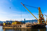 Barge dredging a harbor — Stock Photo