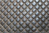 Fragment of a cover of a cast iron manhole close up — Photo