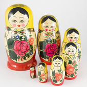 Seven traditional Russian nesting dolls descending spiral — Stock Photo
