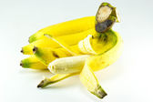 Bunch of bananas with open one on white background — Stock Photo