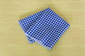 Blue-white checkered tablecloth in an old wooden table — Stok fotoğraf