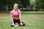 Woman stretching in the park before Exercise. — Stock Photo