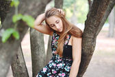 Outdoors portrait of beautiful young girl. — Stock Photo