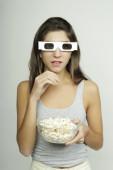 Hispanic woman watching a movie. Cinema concept — Stock Photo