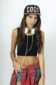 Trendy beautiful model posing with headphones. — Stock Photo