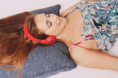 Young woman with red headphones — Stock Photo