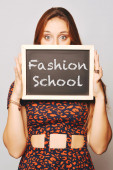 University college student holding a chalkboard saying Fashion S — Stock Photo