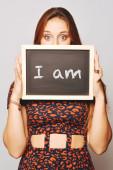 University college student holding a chalkboard saying I am — Stock Photo