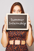 University college student holding a chalkboard saying Summer In — Stock Photo