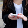 Young woman using her cellphone — Stock Photo #78837086