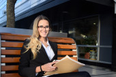 Beautiful business woman outside her office — Stock Photo