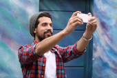Happy young man taking a selfie. — Stock Photo