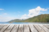 Wood planks floor with blurry Scenic landscape — Stock Photo