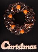 Christmas Wreath And Christmas Wooden Writing On Black. — Fotografia Stock