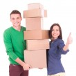 Young couple holding boxes. Moving to a new apartment or house. — Stock Photo #59094455