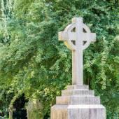 Stone cross on grave — Stock fotografie