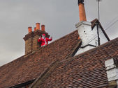 Father Christmas on roof top — Stock fotografie