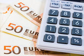 Fifty euro bills and a calculator — Stock Photo